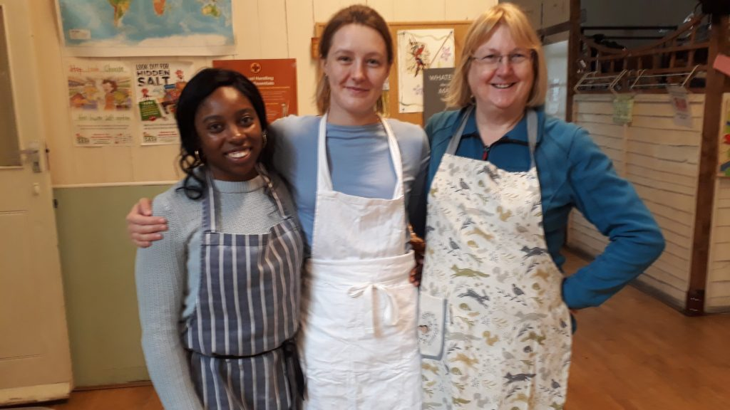 Image of people in aprons